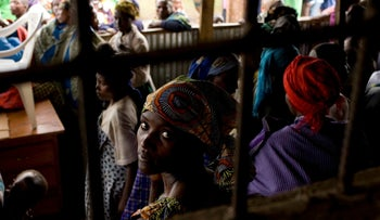File photo: A Congolese woman refugee sits with others at the Nkamira transit centre for refugees in western Rwanda Saturday, May 5, 2012.