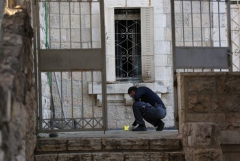 A police officer at the site of the arson at the Dormition Abbey in Jerusalem, 2015.