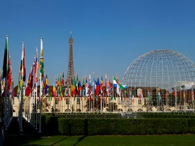 The Eiffel Tower, country flags and the Dome are seen from the garden of the United Nations Educational, Scientific and Cultural Organisation (UNESCO) headquarters building