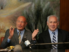 File photo: Israeli-American movie producer Arnon Milchan with Benjamin Netanyahu, as he announces his donation of $100m to establish a new Israeli university, at a press conference in Jerusalem, March 28, 2005.