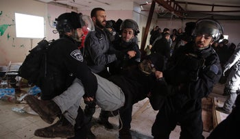 A settler being evicted from the illegal outpost in Amona, January 3, 2019.