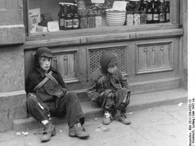 Jewish children in front of Jedydia Merensztejn bakery at Nowolipki 7 street in the Warsaw Ghetto. May 1, 1941