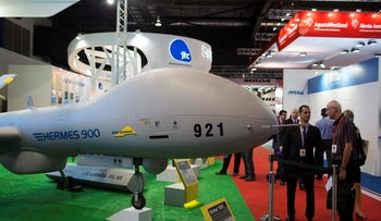 The Hermes 900 unmanned aerial vehicle (UAV) manufactured by Elbit Systems Ltd. stands on display at the company's booth during the Singapore Airshow held at the Changi Exhibition Centre in Singapore, on Tuesday, Feb. 11, 2014.