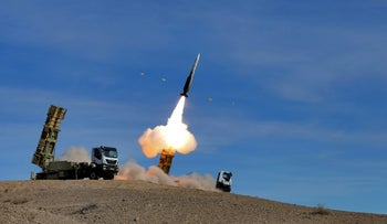 A Sayyad 2 missile is fired by the Talash air defense system during drills in an undisclosed location in Iran in an image released on November 5, 2018.