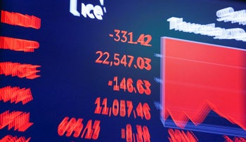 A screen displays the Dow Jones Industrial Average after the close of trading on the floor of the New York Stock Exchange (NYSE) in New York City, U.S., December 27, 2018