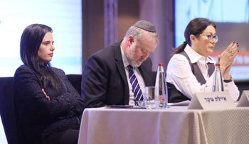 Supreme Court President Esther Hayut, Attorney General Avichai Mendelblit and Justice Minister Ayelet Shaked at a legal convention in Haifa, January 3, 2018.