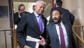 Rep. Hank Johnson, D-Ga., left, and Rep. Al Green, D-Texas, exit a Democratic Caucus meeting in the basement of the Capitol as new members of the House and veteran representatives gathered behind closed doors to discuss their agenda when they become the majority in the 116th Congress, in Washington, Thursday, Nov. 15, 2018.