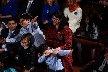 Rashida Tlaib wearing a traditional Palestinian dress with her children during the 116th Congress and swearing-in ceremony, January 3, 2019.