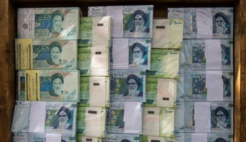 Iranian rial banknotes stand on display at a currency exchange in Tehran, Iran, on Saturday, Nov. 3, 2018.