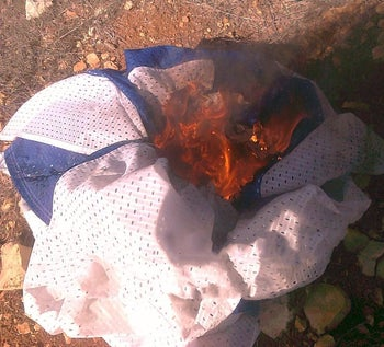 An Israeli flag set on fire by Jewish terror suspects, January 6, 2019.