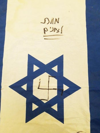 The Israeli flag presented by the Shin Bet as having been vandalized by the terror suspects in the Aisha Rabi murder. January 6, 2019