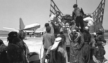Iraqi Jewish refugees leaving Lod airport (Israel) on their way to to a transit camp, 1951