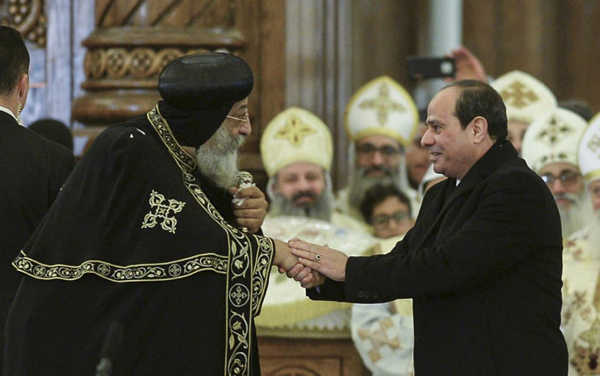 Egypt's President Abdel Fattah al-Sisi (R) speaks as Coptic Pope Tawadros II listens during the inauguration of the massive Cathedral of the Nativity of Christ in Egypt's New Administrative Capital, 45 kilometres (28 miles) East of Cairo, on January 6, 2019