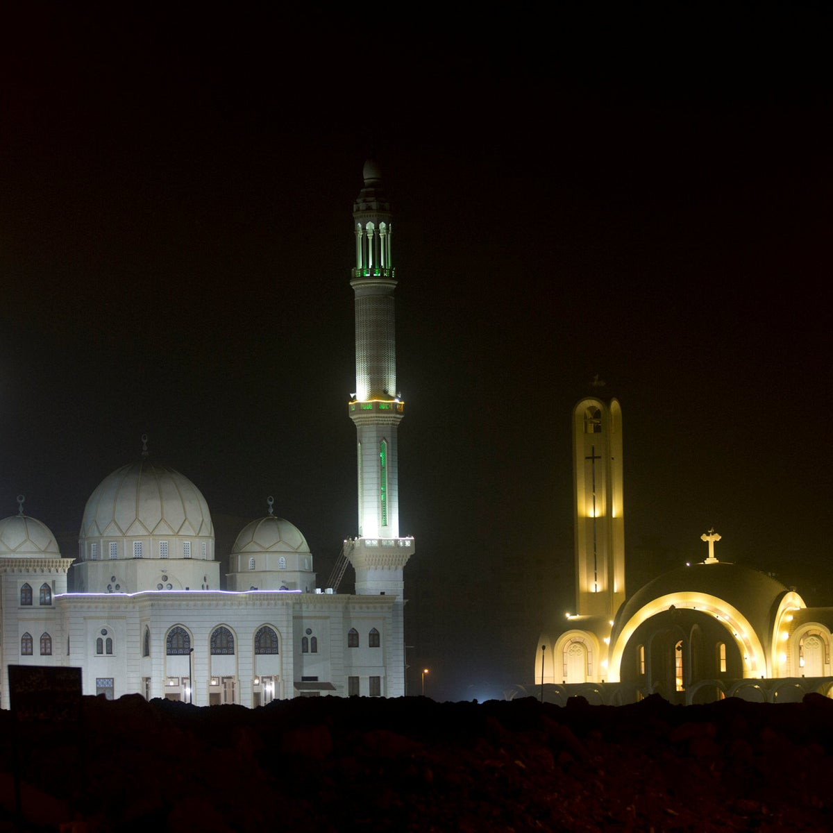 """The """"Great St. Antony Church"""", right, and the Great mosque, left, are illuminated in Cairo, Egypt, Sunday, Jan. 6, 2019."""