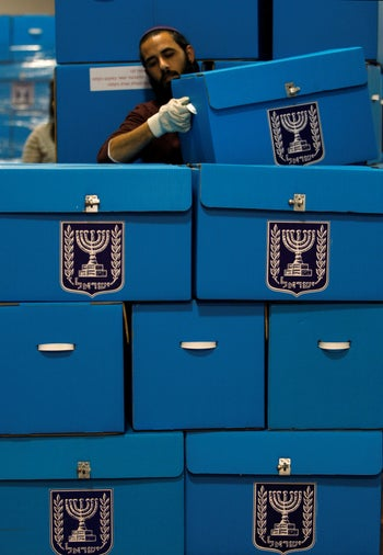 A worker stacks ballot boxes in a warehouse in Shoham, near Tel Aviv January 29, 2009.