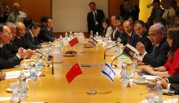 Prime Minister Benjamin Netanyahu, right, and China's Vice President Wang Qishan sit during their meeting in Jerusalem, Wednesday, Oct. 24, 2018