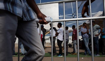FILE Photo: Asylum seekers in line outside Population, Immigration and Border Authority offices in Bnei Brak.