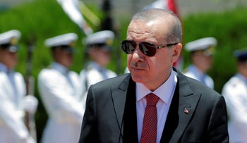 Turkish President Tayyip Erdogan attends a welcoming ceremony at the Presidential Palace in Asuncion, Paraguay, December 2, 2018.