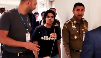 Rahaf Mohammed al-Qanun being escorted by a Thai immigration officer and UNHCR officials at Suvarnabhumi international airport in Bangkok, Thailanad, January 7, 2019.