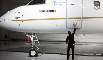 An employee opens the door on a Bombardier Inc. Global 7500 luxury jet during a launch event in Montreal, Canada, December 20, 2018.