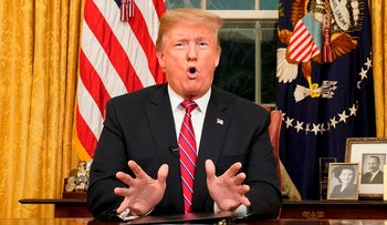U.S. President Donald Trump delivers a televised address to the nation on funding for a border wall from the Oval Office of the White House in Washington DC on January 8, 2019