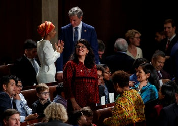 Then Rep.-elect Rashida Tlaib of Michigan looks to the gallery from the house floor before being sworn into the 116th Congress at the U.S. Capitol in Washington. Jan. 3, 2019