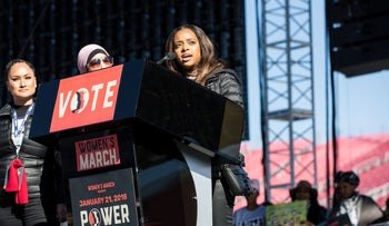 Tamika Mallory, co-chair for the Women's March, right, speaks as fellow co-chairs Carmen Perez, left, and Linda Sarsour listen during the Women's March One-Year Anniversary: Power To The Polls event in Las Vegas, Nevada, U.S., on Sunday, Jan. 21, 2018