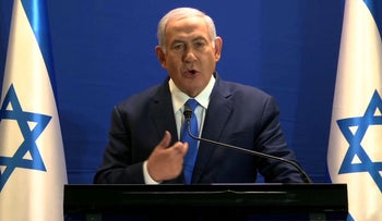 Frame grab taken off a video released by Likud shows Israeli Prime Minister Benjamin Netanyahu delivering a statement live at the Prime Minister's office in Jerusalem on January 07, 2019.