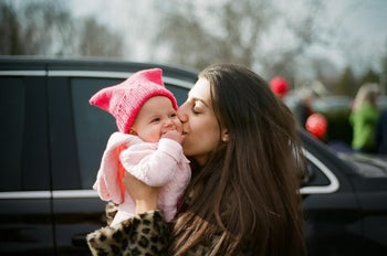 Jamie Oksenhorn and daughter Alma wearing a pink 'pussyhat.' The Jewish mom was a proud attendee of the 2018 Women's March in Morristown, New Jersey, but will not be taking part in 2019's rally.