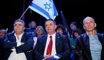 Labor Party chief Avi Gabbay (center) flanked by Amir Peretz (left) and Omer Bar-Lev (right) at the party's conference in Tel Aviv, January 10, 2019.