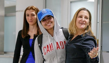 Rahaf Mohammed al-Qunun, accompanied by Canadian Minister of Foreign Affairs Chrystia Freeland and Saba Abbas, general counselor of COSTI refugee service agency, arrives in Toronto, Ontario, Canada, January 12, 2019.