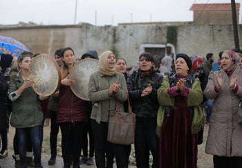 File photo: Women chant slogans during a protest near the Syrian-Turkish border in Ras al-Ayn town, Syria, December 20, 2018.