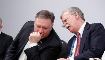 U.S. National Security Advisor John Bolton and Secretary of State Mike Pompeo at the White House in Washington, U.S., October 11, 2018.