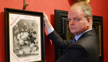 "Florence Uffizi Galleries director Eike Schmidt posing past a copy of the ""Vase of Flowers"" by Dutch painter Jan van Huysum, stolen from the Wehrmacht's Pitti Palace during World War II, in Florence, January 1, 2019."