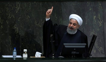 Iran's President Hassan Rohani speaks in a parliament session in Tehran, December 10, 2017.