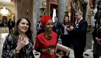 U.S. Rep. Ilhan Omar walks through statuary hall with her Legislative Director Kelly Misselwitz on Capitol Hill in Washington, U.S., January 16, 2019.