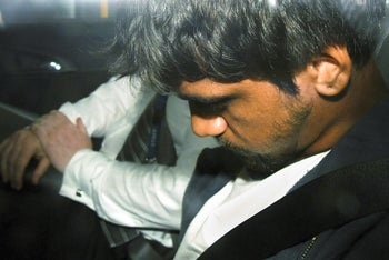 20-year-old man sits in a police car after he was arrested for questioning over the death of Israeli student Aya Masarwe in Melbourne, Australia, January 18, 2019.