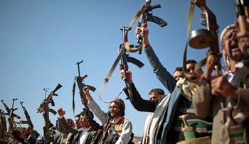File photo: Tribesmen loyal to Houthi rebels hold up their weapons as they attend a gathering to show their support for the ongoing peace talks in Sanaa, Yemen, December 13, 2018.