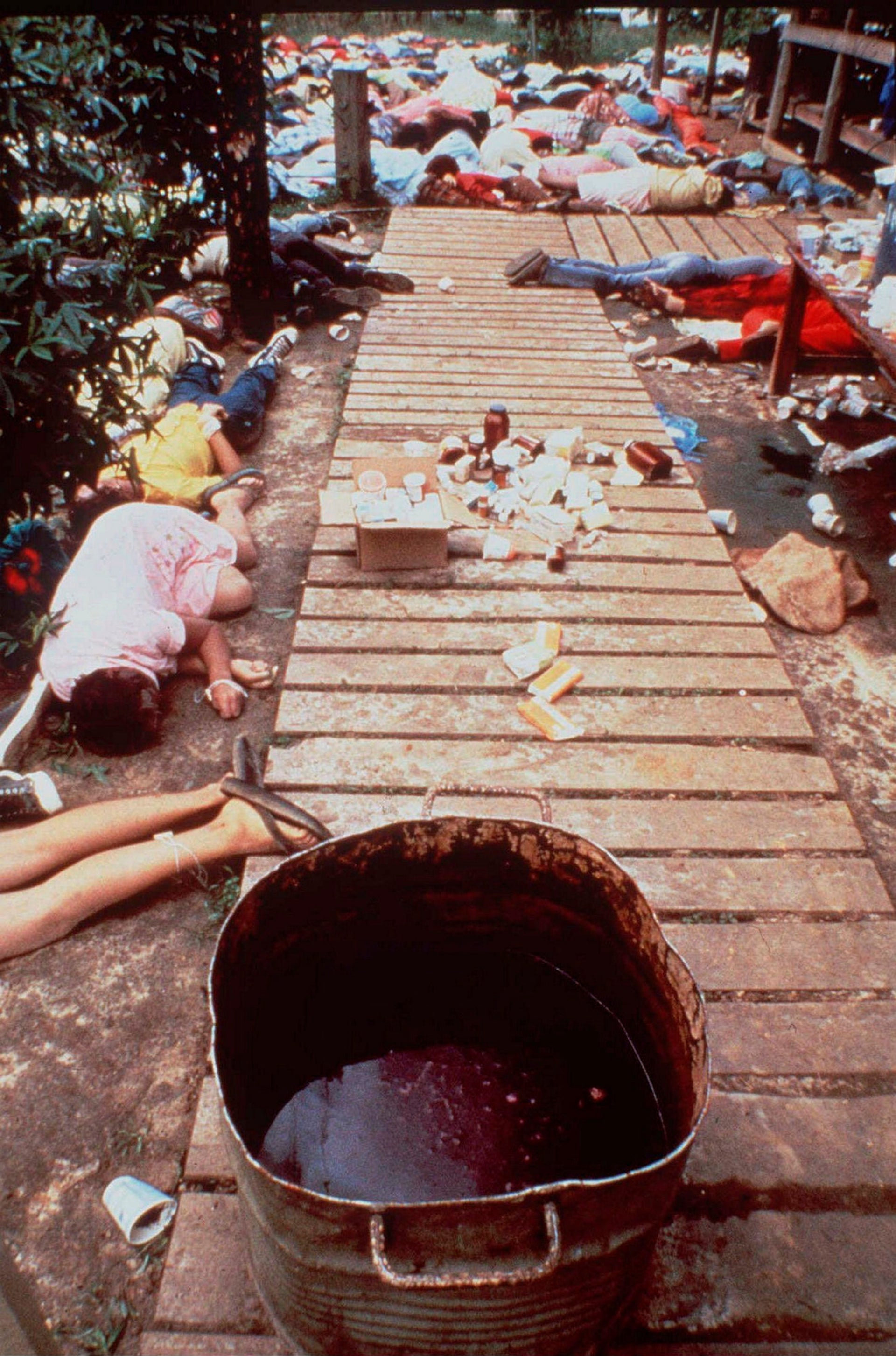 File photo: A vat that contained a drink laced with deadly cyanide sits on a sidewalk at Peoples Temple in Jonestown, Guyana, November 20, 1978.