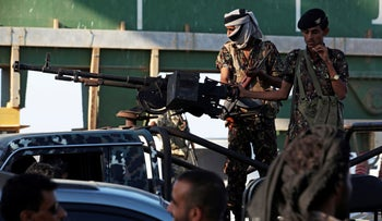 Soldiers allied to Yemen's government stand guard at the port of Aden, Yemen, December 12, 2018.