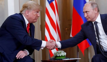 FILE PHOTO: U.S. President Donald Trump and his Russian counterpart Vladimir Putin shaking hands during a meeting at the Residential Palace in Helsinki, Finland, July 2018.
