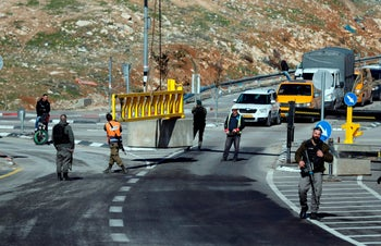 Israeli police secure the entrance to a divided road and put a new barrier in the section to be used by Palestinian drivers near the West Bank town of al-Zayyem. January 10, 2019