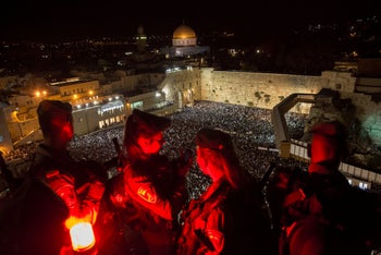 Jewish worshippers fill the plaza in front of the Western Wall on the last round of special night-time penitential prayers before Yom Kippur. 29 September, 2017