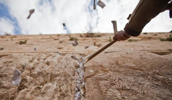 The annual removal of notes placed in the Western Wall by visitors before Passover. 6 April 2011