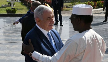 Israeli Prime Minister Benjamin Netanyahu is greeted by Chad's President Idriss Deby upon his arrival in N'Djamena, Chad January 20, 2019.
