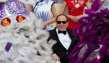 File photo: Sheldon Adelson watches a traditional lion dance during the opening of the Sands Cotai Central resort in Macau, China, April 11, 2012.