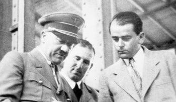 File Photo: Prof. Albert Speer (right), discusses plans for a building with German Chancellor Adolf Hitler, February 19, 1937.