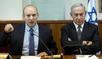 FILE PHOTO: Netanyahu sits with Israeli Education Minister Naftali Bennett during the weekly cabinet meeting in Jerusalem, on Tuesday, August 30, 2016.