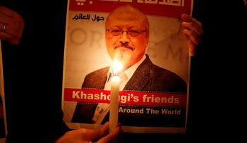 File photo: A demonstrator holds a poster of Jamal Khashoggi in Istanbul, October 25, 2018.