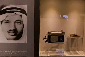 Personal items belonging to Yasser Arafat on display next to his picture at the Ramallah museum in his honor.